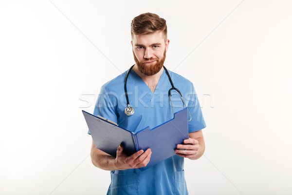 Upset disappointed medical doctor or a nurse with stethoscope Stock photo © deandrobot