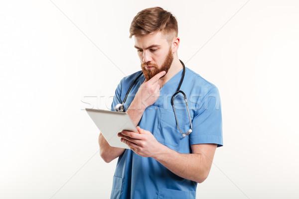 концентрированный врач медсестры мышления глядя Сток-фото © deandrobot