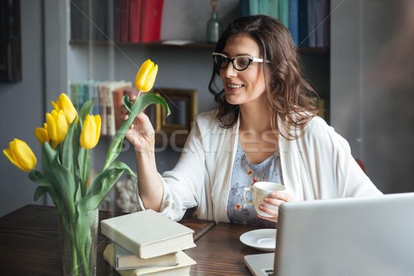 Nő szemüveg ül asztal csésze tea Stock fotó © deandrobot