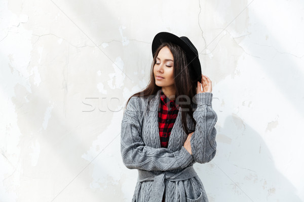 Young woman with closed eyes standing against sun Stock photo © deandrobot