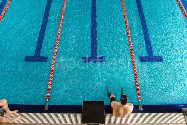 Top view of a male swimmer sitting Stock photo © deandrobot