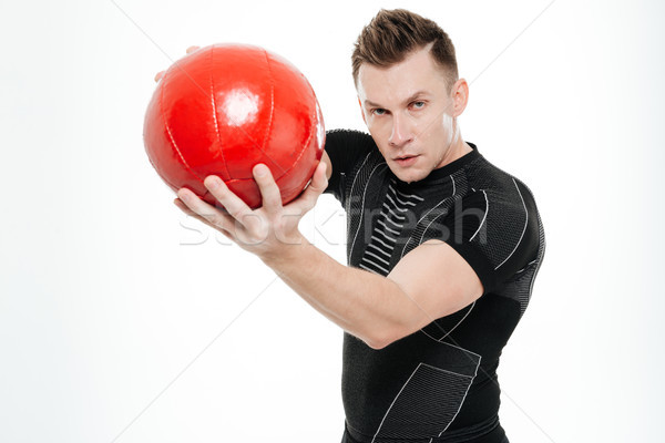 Atractivo hombre pesado fitness pelota retrato Foto stock © deandrobot