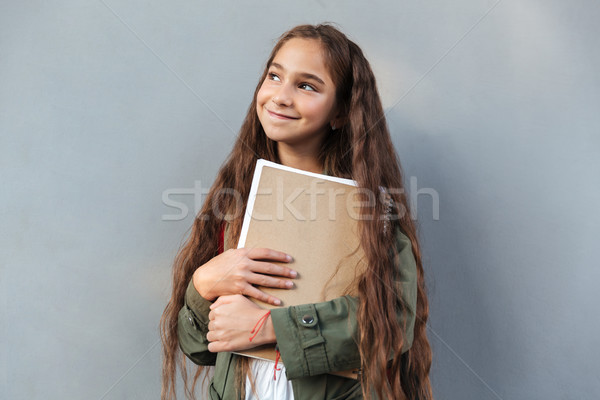 Smiling brunette schoolgirl with long hair dressed in warm clothes Stock photo © deandrobot