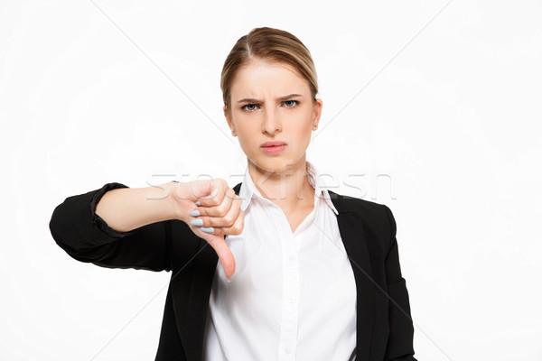 Niezadowolony poważny business woman kciuk Zdjęcia stock © deandrobot