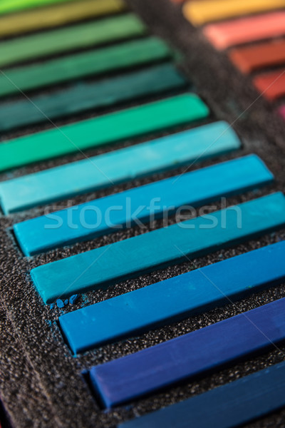 Cropped photo of new colorful chalk pastels in box Stock photo © deandrobot