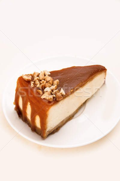Cheesecake with caramel and nuts on it Stock photo © deandrobot