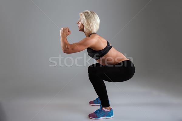 Vista laterale concentrato muscolare adulto isolato Foto d'archivio © deandrobot