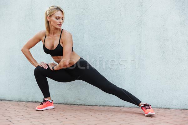 Elképesztő erős fiatal sportok nő gyártmány Stock fotó © deandrobot