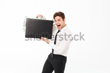 Portret gelukkig tevreden zakenman tonen aktetas Stockfoto © deandrobot