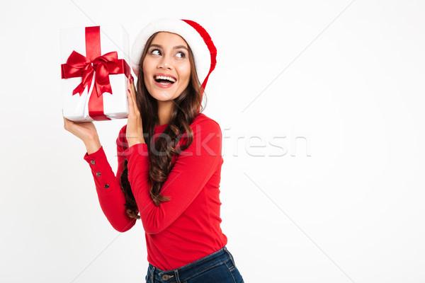Portrait of a joyful pleased asian woman Stock photo © deandrobot
