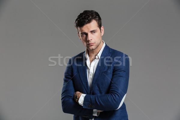 Retrato sério concentrado homem jaqueta posando Foto stock © deandrobot