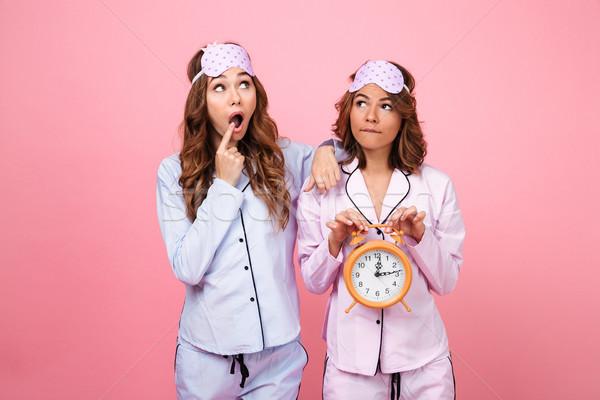 友達 女性 パジャマ 目覚まし時計 ストックフォト © deandrobot