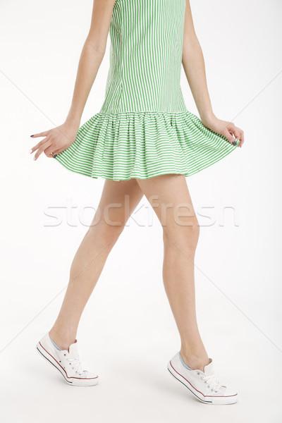 Fél test portré fiatal lány ruha sétál Stock fotó © deandrobot
