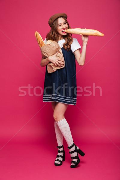 Drôle dame manger fraîches baguette isolé Photo stock © deandrobot