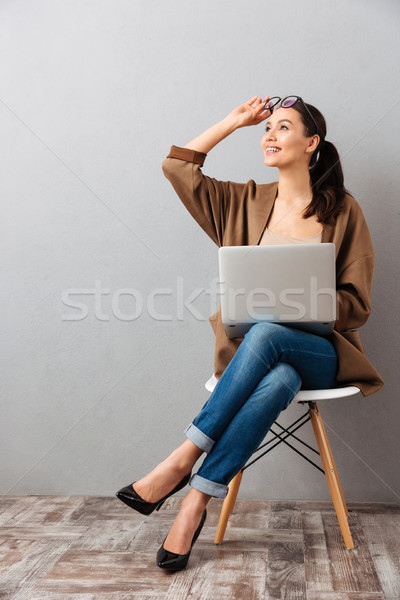 Full length portrait of a cheery casual businesswoman Stock photo © deandrobot