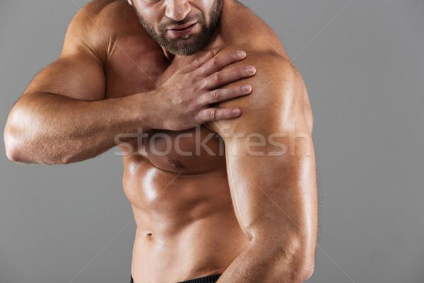 Közelkép portré erős izmos férfi testépítő Stock fotó © deandrobot