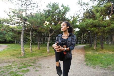Hátulnézet fiatal fitnessz nő jogging kint út Stock fotó © deandrobot