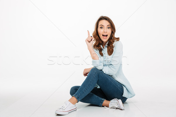 Happy young woman have an idea. Stock photo © deandrobot