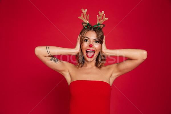 Retrato animado surpreendido menina natal Foto stock © deandrobot