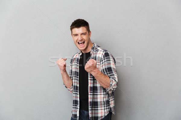 Ritratto felice giovane vittoria grigio Foto d'archivio © deandrobot