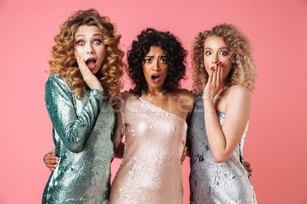 Tres hermosa conmocionado mujeres brillante vestidos Foto stock © deandrobot