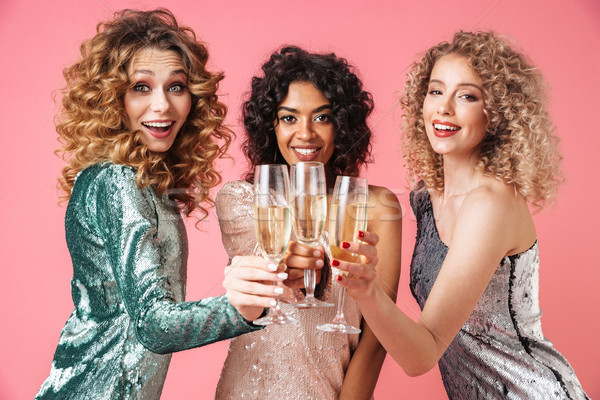 Stock photo: Three beautiful happy women in shiny dresses