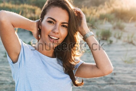 Cheery young girl taking a selfie with mobile phone Stock photo © deandrobot