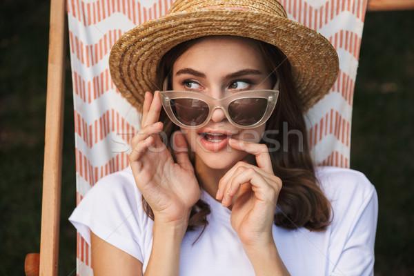 Fiatal lány napszemüveg pihen függőágy város park Stock fotó © deandrobot