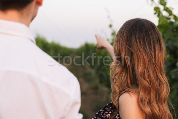 Photo from back closeup of european couple man and woman, walkin Stock photo © deandrobot