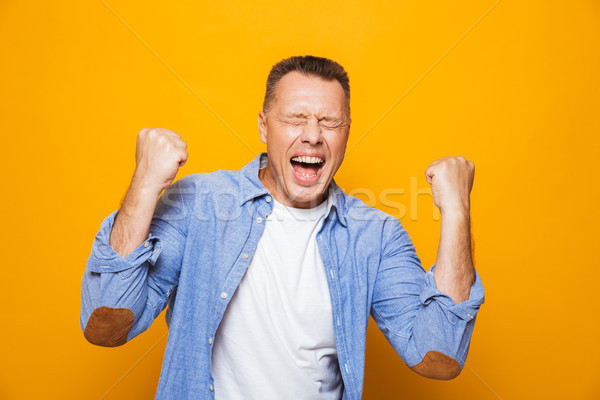 Portrait of an energetic middle aged man Stock photo © deandrobot