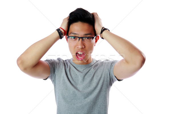 Portrait of a frightened young asian man over white background Stock photo © deandrobot