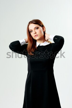 Young beautiful woman in casual dress touching her head Stock photo © deandrobot