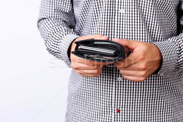 Wallet with money in hand Stock photo © deandrobot