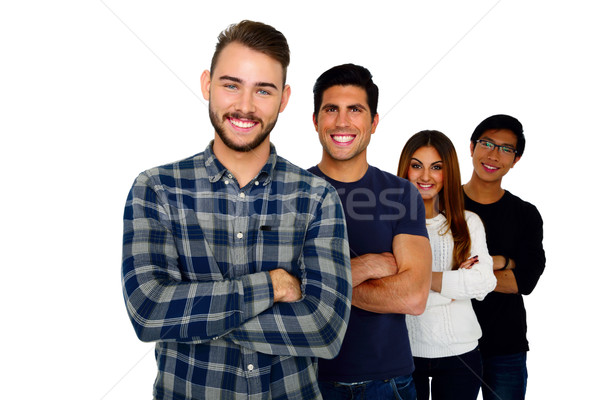 Cheerful young students standing in a row over white background Stock photo © deandrobot