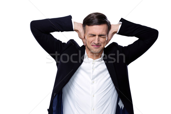 Businessman holding hands on the ears over white background Stock photo © deandrobot