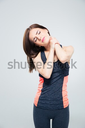 Sporty young woman with neck pain Stock photo © deandrobot