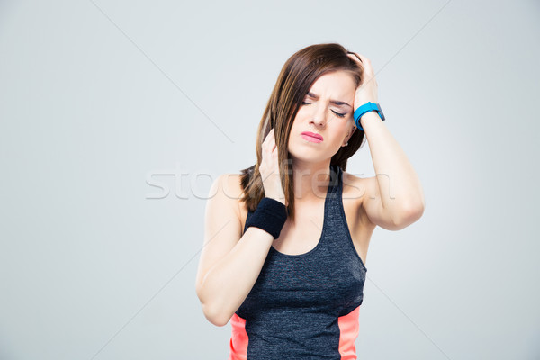 Sports woman having headache Stock photo © deandrobot
