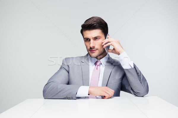 Confident businessman talking on the phone Stock photo © deandrobot