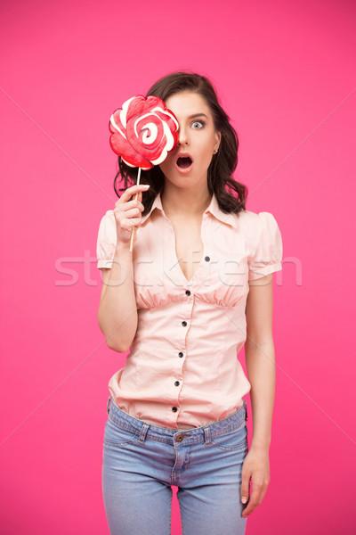 Kadın göz lolipop şaşırmış pembe Stok fotoğraf © deandrobot