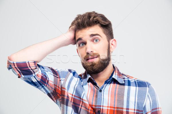 Portré meglepett férfi néz kamera fiatalember Stock fotó © deandrobot