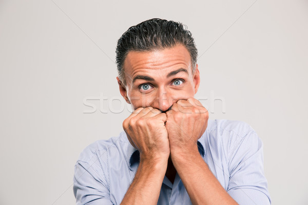 Portrait of a scared young man Stock photo © deandrobot