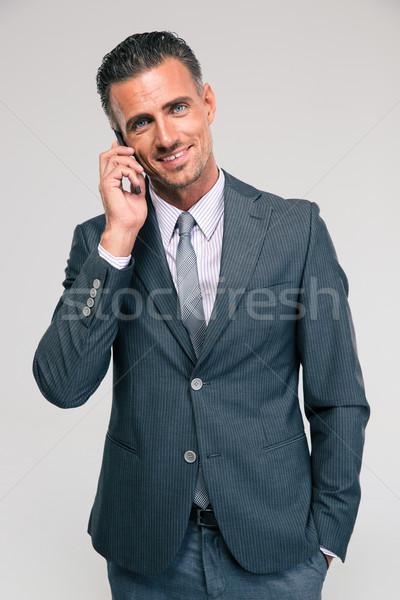 Stockfoto: Portret · gelukkig · zakenman · praten · telefoon · geïsoleerd