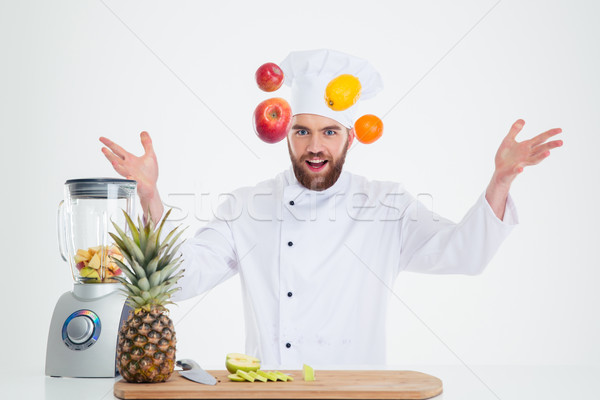 Portrait of a hapy male chef cook juggle with fruits  Stock photo © deandrobot