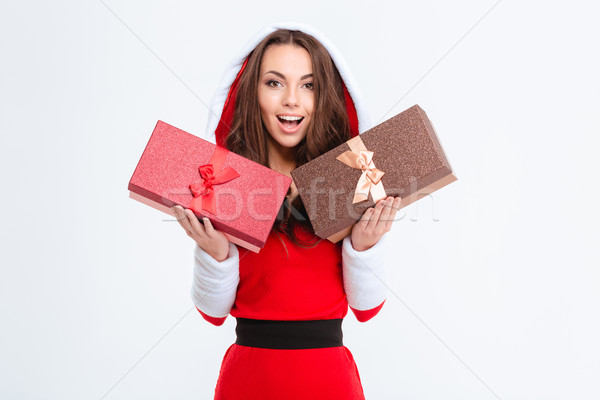 Amazed lovely excited girl in santa claus costume holding presents  Stock photo © deandrobot