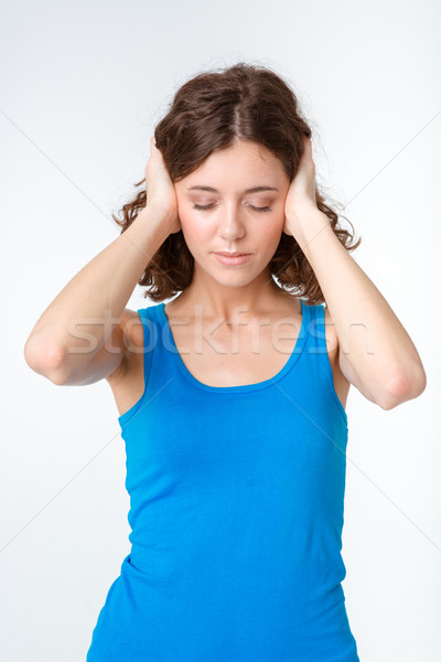 Portrait of a young woman closed her ears Stock photo © deandrobot