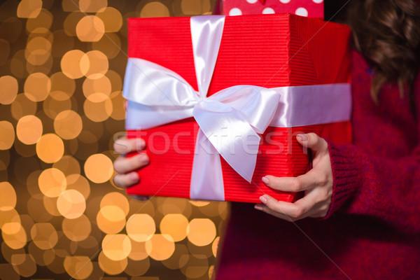 Piros ajándék doboz fiatal női kötött Stock fotó © deandrobot