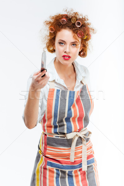 Beautiful housewife holding knife  Stock photo © deandrobot