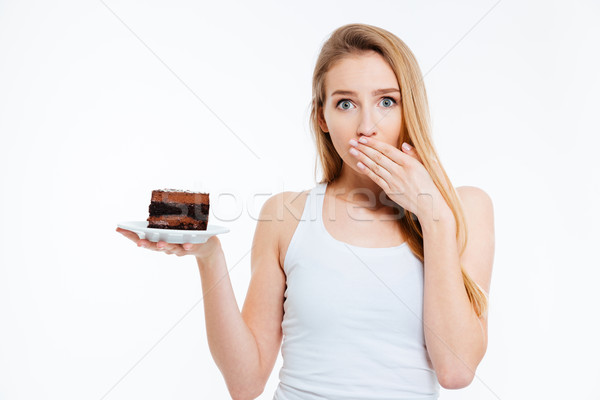 Beautiful confused woman on diet holding piece of chocolate cake Stock photo © deandrobot