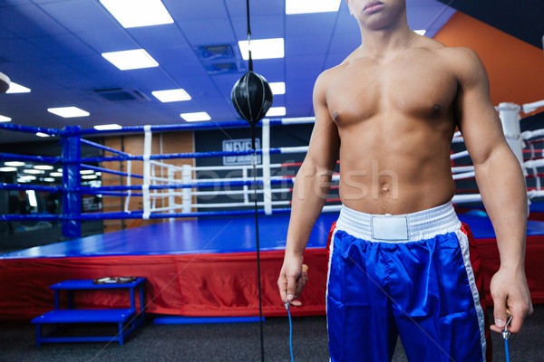 Stock photo: Boxer standing near boxing ring