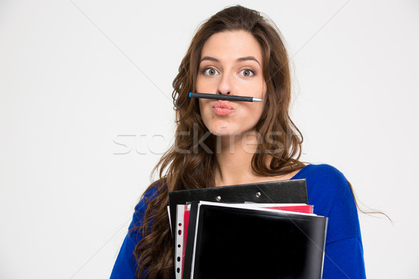 Amusing comical woman making funny face with pen  Stock photo © deandrobot